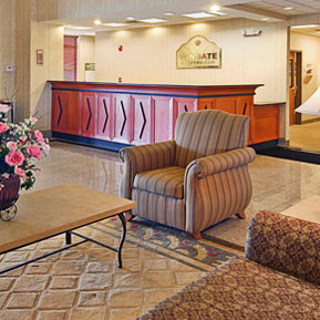 Wingate main lobby red reception desk and lounge area